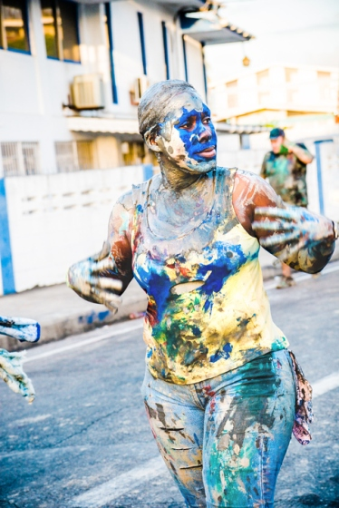 PORT OF SPAIN, TRINIDAD W. I. - FEBRUARY 4, 2008: A female reveller wearing mud and paint in the early morning, as J'Ouvert celebrations wind down after all night partying during Carnival season.